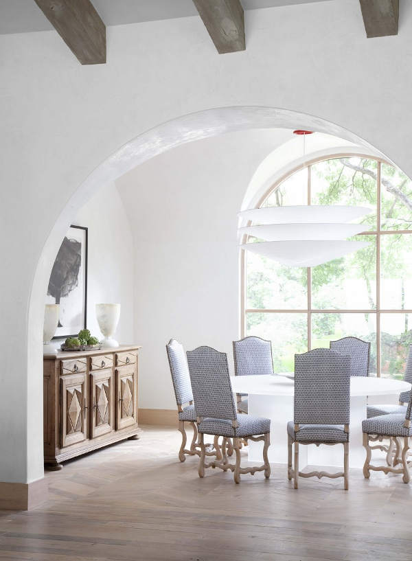 The dining space is by the window, so it's filled with light, and I love blue upholstered chairs very much