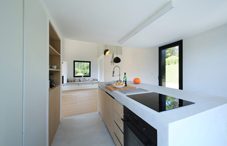 The kitchen is minimalist, with a micro cement topping, like the floor finish, it's very durable