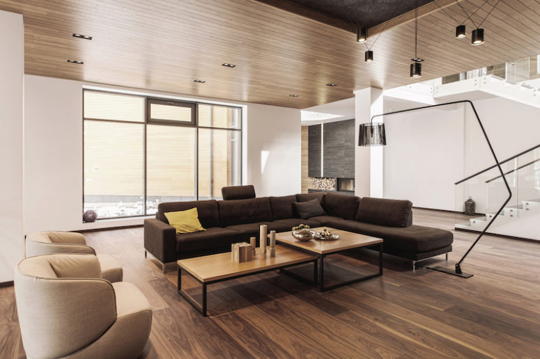 The living room is centered around an L-shaped sectional and a pair of coffee tables