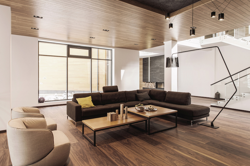 The living room is centered around an L shaped sectional and a pair of coffee tables