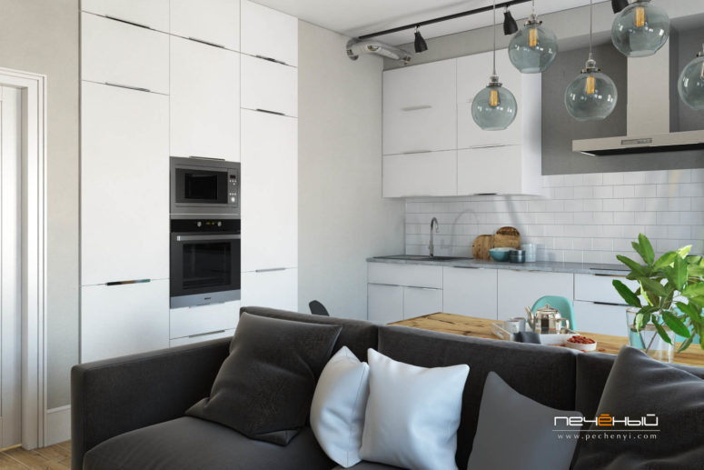 The modern white kitchen in grey and white with subway tiles is fresh and functional, no handle cabinets look neat