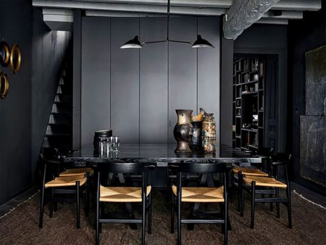 a black stone top table is accentuated with black and yellow chairs
