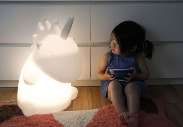 a giant unicorn table lamp will excite kids and adults too