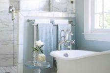 05 a light blue bathroom with a slip clawfoot tub with white legs