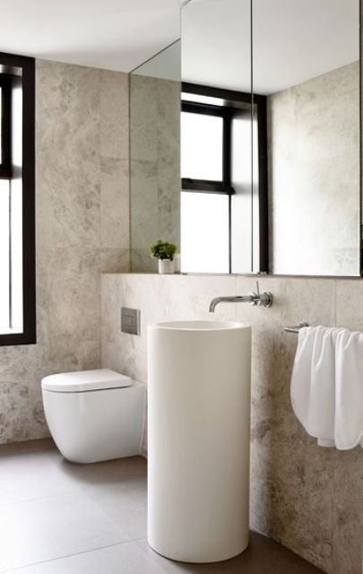 a small round free-standing sink makes the bathroom modern