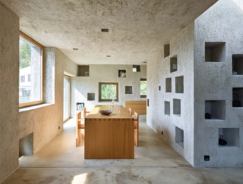 Concrete openings are used for storage inside the house, and lots of windows bring much light in