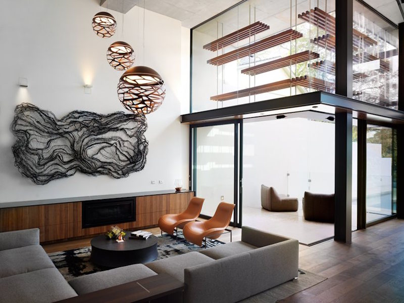 I love the open spaces inside, with elegant copper details and sculptural elements
