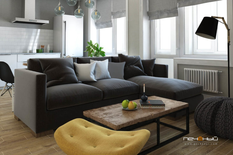 I love the rustic wood coffee table, a knitted pouf, a sunny yellow chair for a bold touch, and a graphite grey sofa works as a space divider
