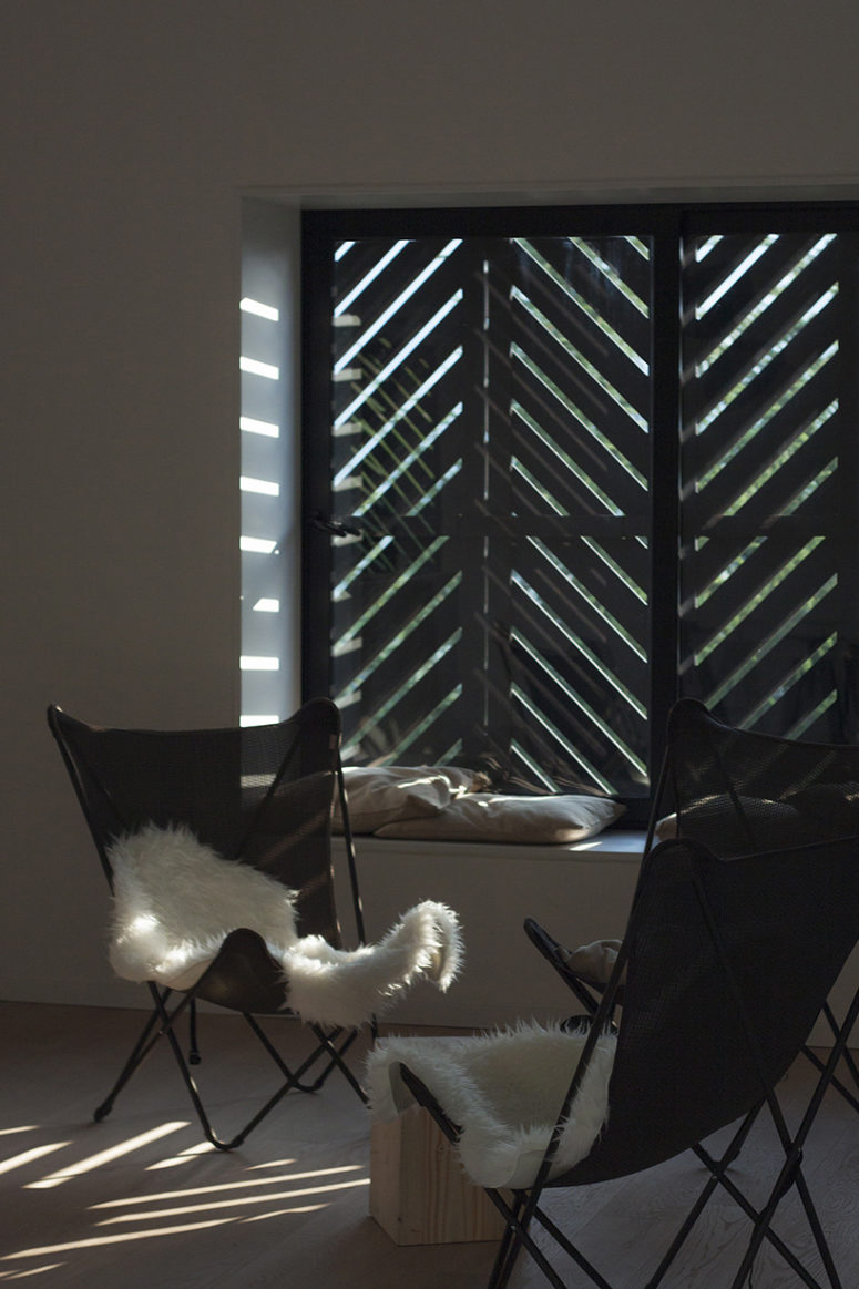 Window shutters closed creates lighting and shadow plays
