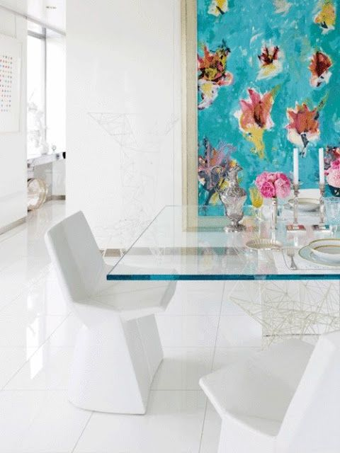 a glass top dining table for modern feminine space and white sculptural chairs