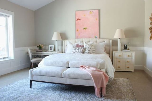 a modern white sideboard and a vanity are ideal as bedside tables for a girlish bedroom