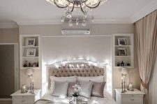 06 a neutral and refined bedroom with a vintage-inspired chandelier with crystals and a fabric lampshade