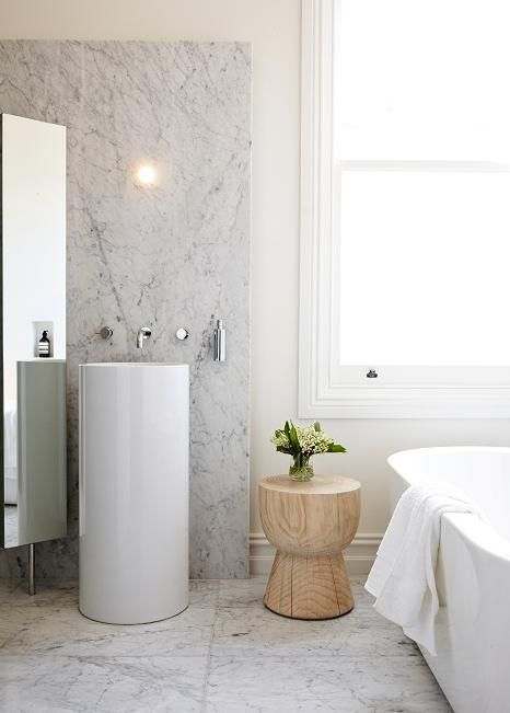 a round free-standing sink easily makes any bathrooom fresher and more modern