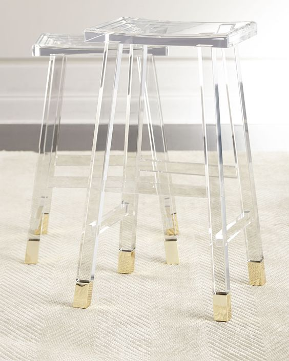 acrylic and brass stools are a chic solution for a modern kitchen