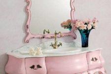 06 vintage pink bathroom vanity with a matching mirror