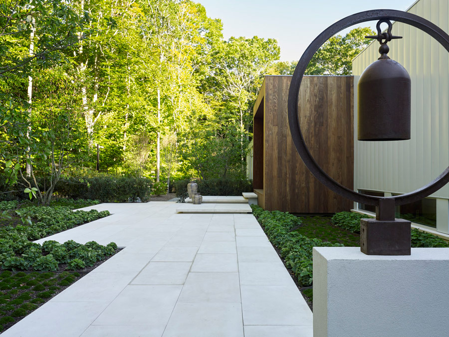 Separate volumes, greenery around and various installations create a cool image