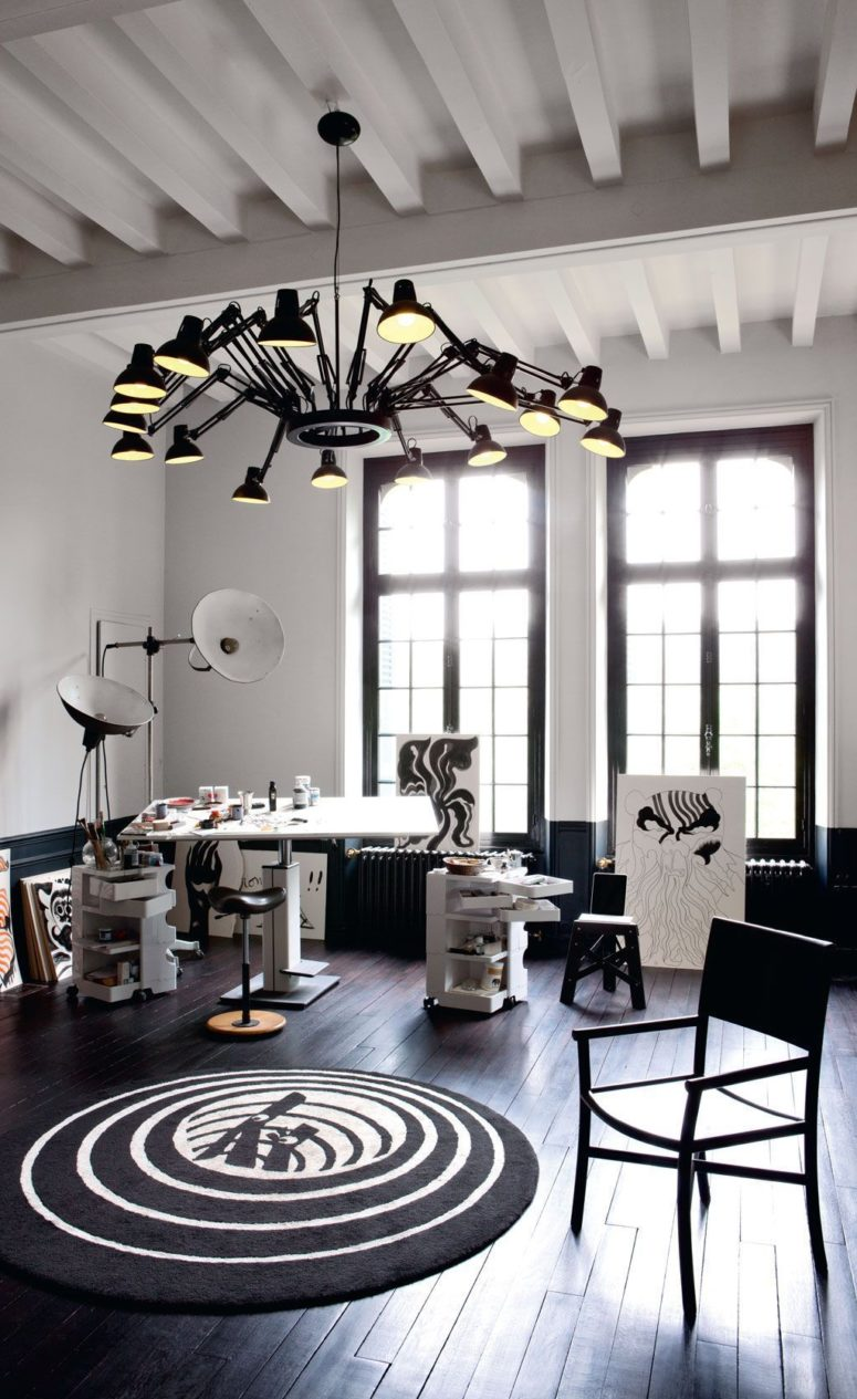 This is another studio space done in the same style, with the same lamps and similar decor