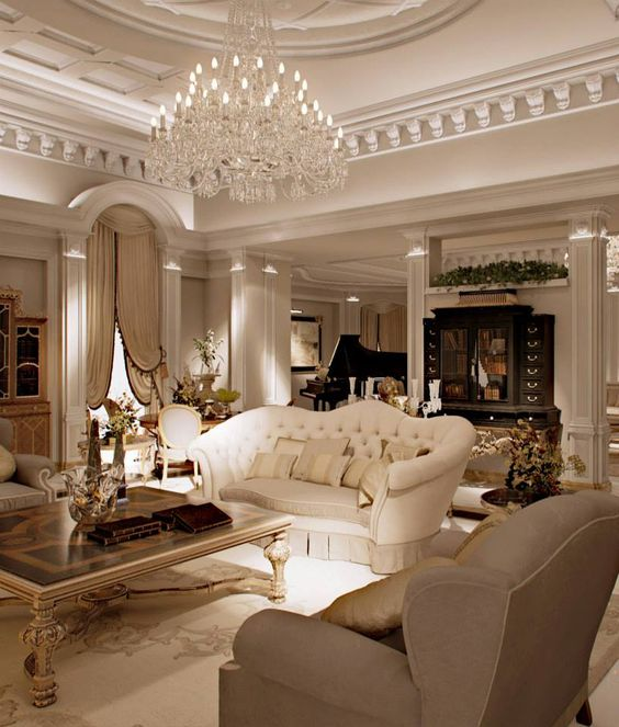 a refined living room with an oversized crystal chandelier with a lot of bulbs