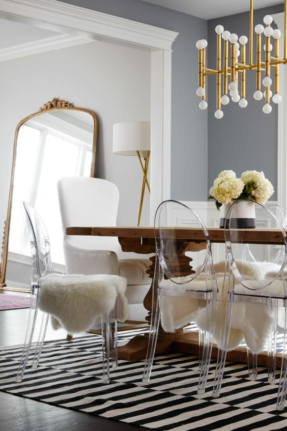 acrylic chairs for a dining room look chic with fur covers