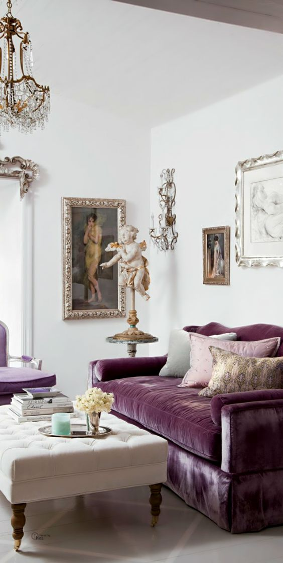 antique-style purple couch with an upholstered base and a matching chair