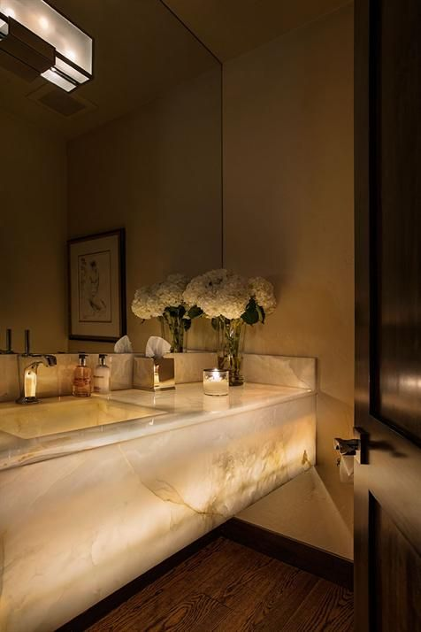 refined and luxurious lit up marble bathroom vanity