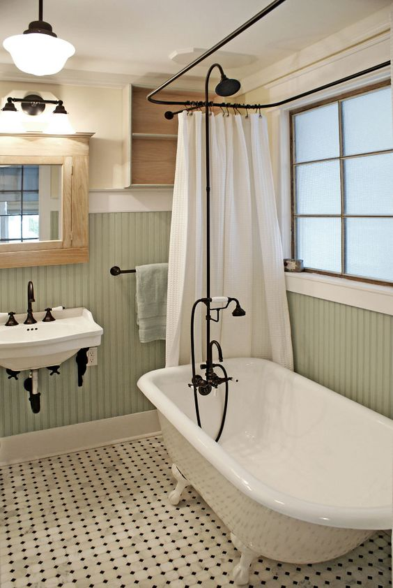 vintage-inspired bathroom with a clawfoot tub and black accents to pull everything off