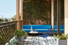 08 A small terrace or a big balcony is covered with greenery and there are potted succulents