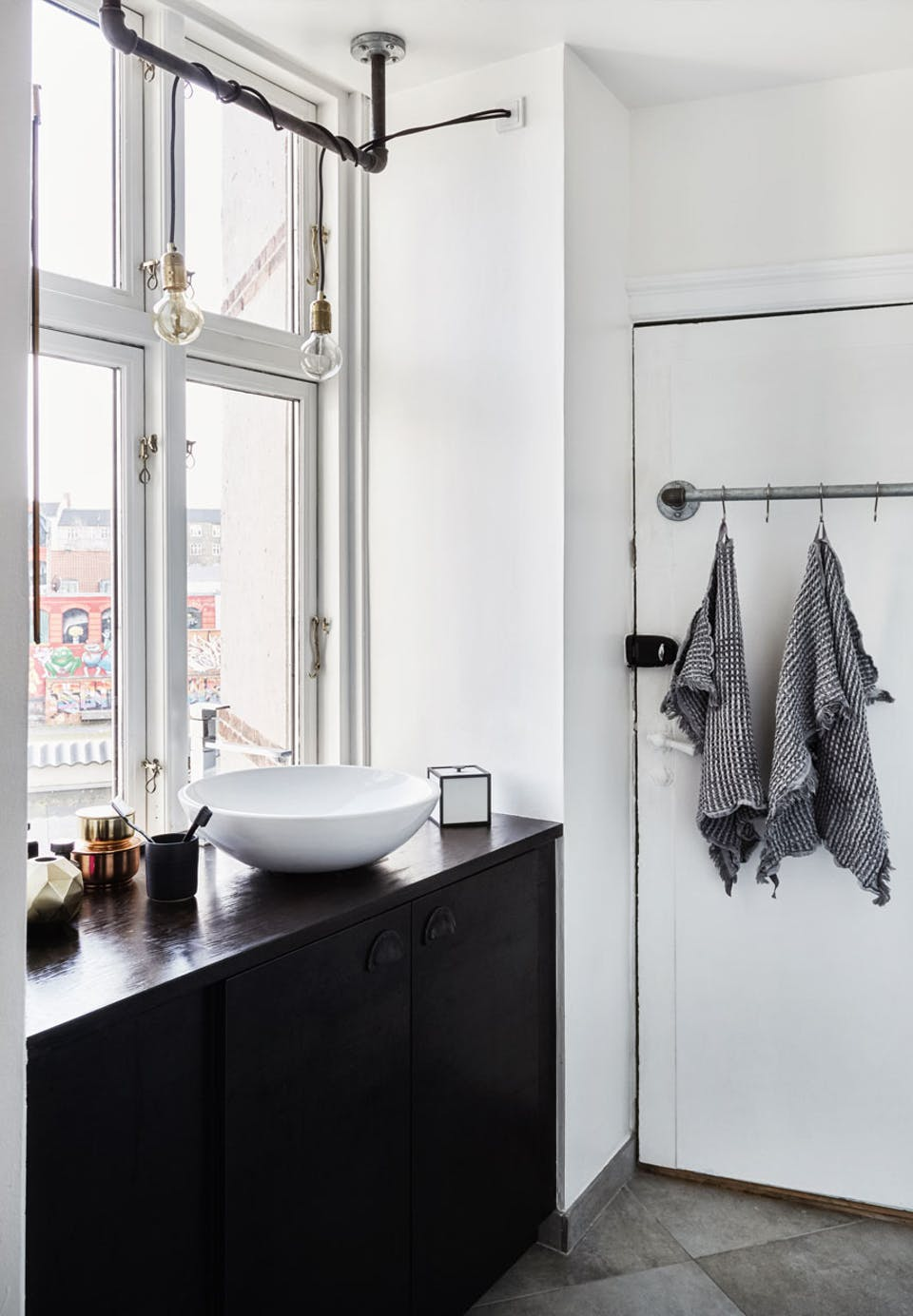 black cabinets in a bathroom