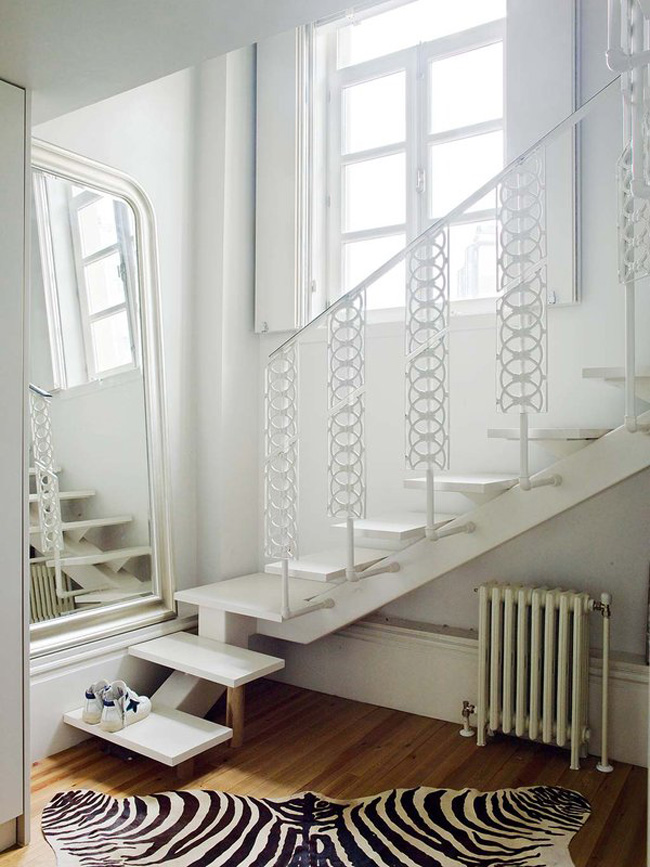 White is actually wide used in this apartment, and it expands the space