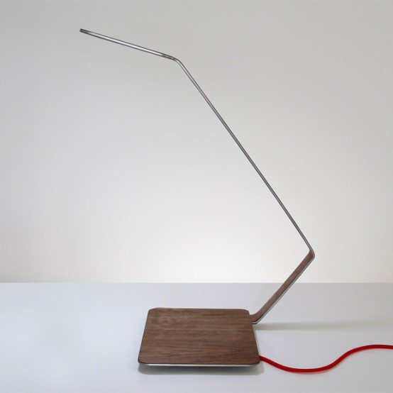 minimalist table lamp with a wooden base and a metal part