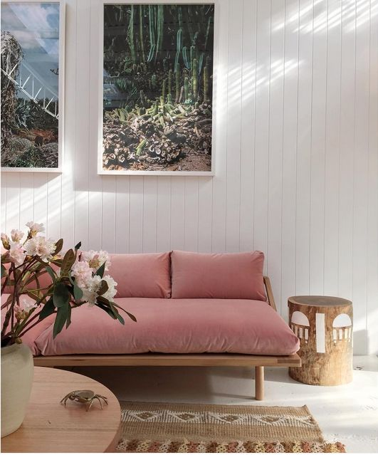 modern pink sofa on a light wooden base with legs