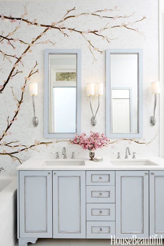powder blue double vanity and matching mirror frames for a girlish bathroom