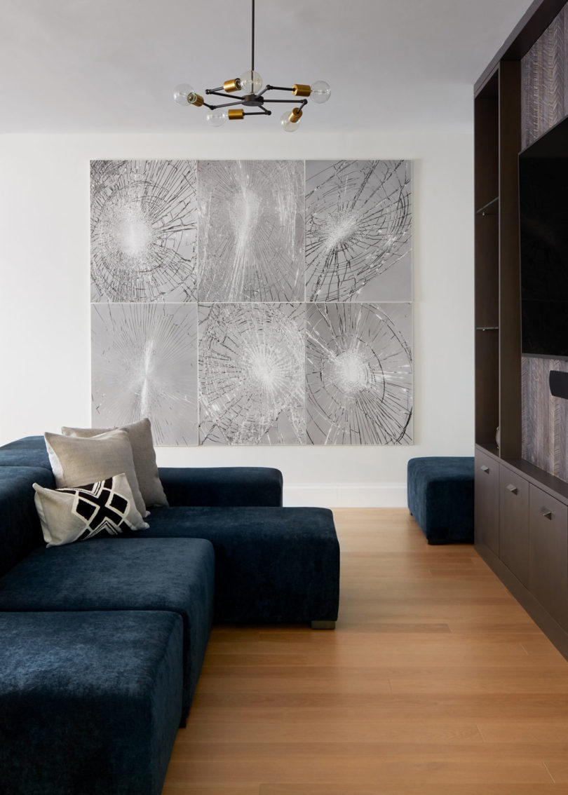 The crcked glass artworks make a bold statement in this space and remind that this is a bachelor's apartment