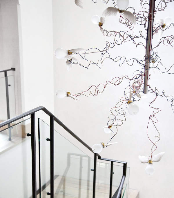 The stairs are marked with a snitch-inspired chandelier, which looks crazy and cute