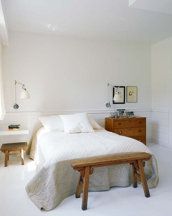 a rustic sideboard as a nightstand and a floating white shelf for a modern look