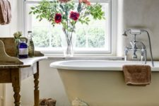09 rustic bathroom with an ivory bathtub with white legs on a wooden stand