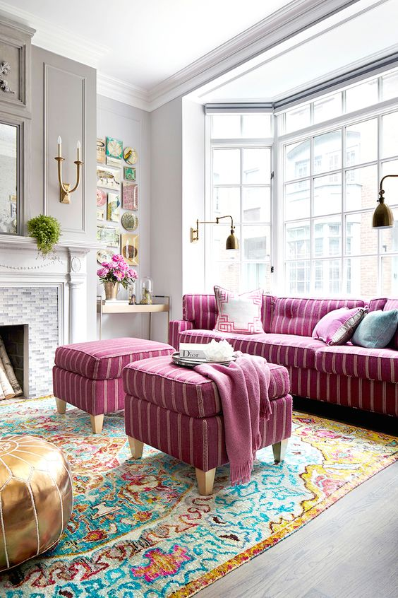 striped bold pink sofa and matching stools or ottomans for a boho-inspired room