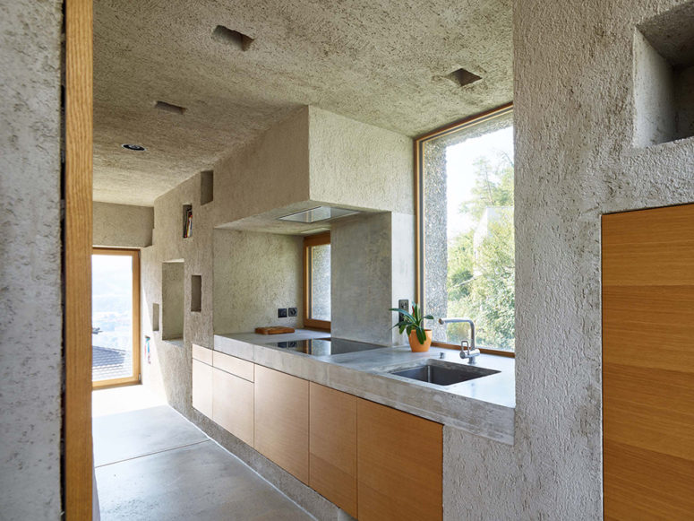 The kitchen is also made of concrete completely, and is clad with oak wood