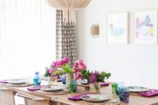 10 a modern boho dining space with wicker furniture and a large glam chandelier