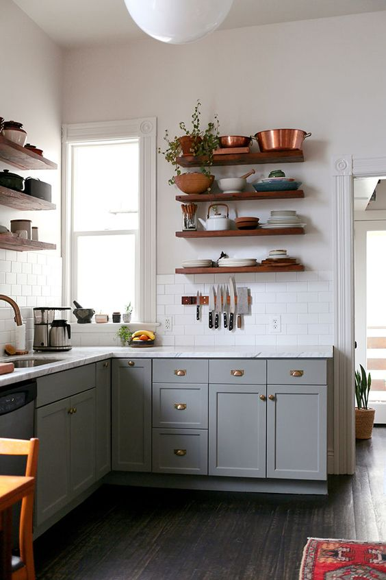 dark stained wooden floating shelves for a traditional kitchen look