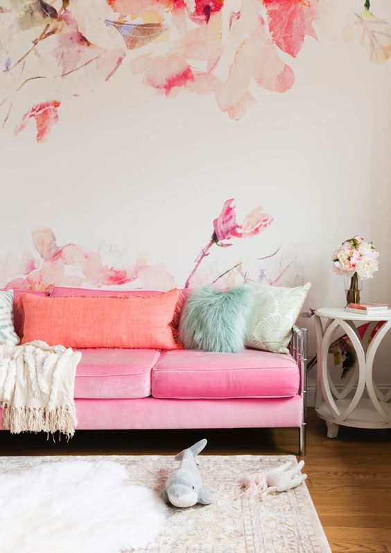 Pink Sofa With Peachy Pillows And Nickel Legs