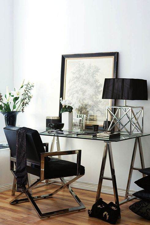 stylish metal leg and a glass top desk looks very masculine