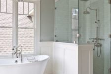 10 vintage-inspired bathroom in neutral colors with a white clawfoot bathtub on silver legs