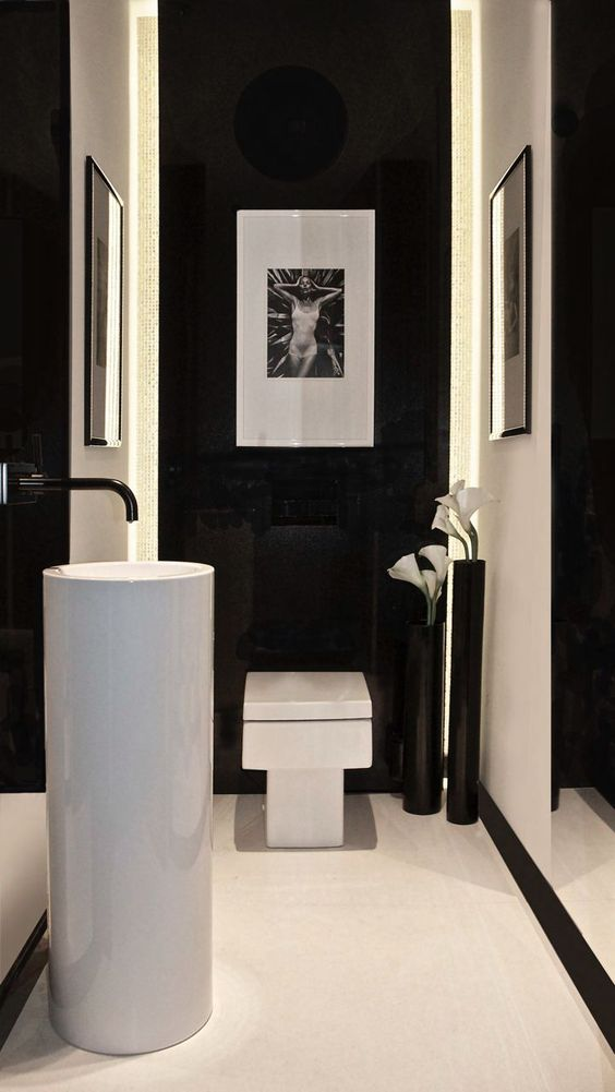 white free-standing sink in a black and white bathroom