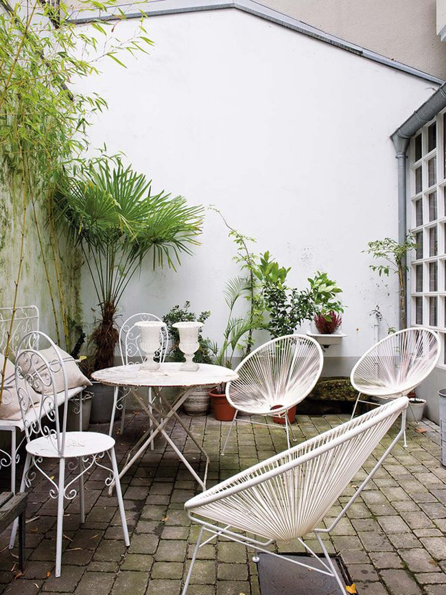 There's also a terrace with mid-century modern furniture and greenery