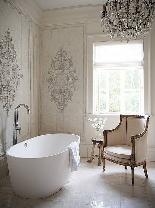 a free-standing bathtub in white looks stylish and chic