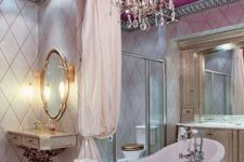 11 a vintage feminine bathroom with a pink ceiling and a lawfoot tub, a vintage crystal chandelier