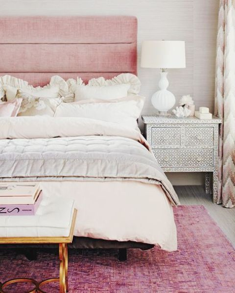 bed with a pink upholstered headboard for a glam feel