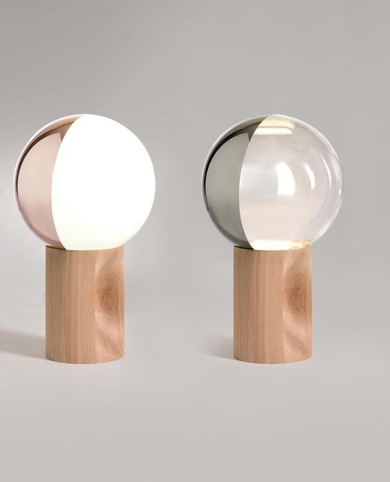 cute table lamps with a closed round color blocked shade and a wooden base