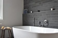 11 peaceful grey tile bathroom with a large freestanding bathtub
